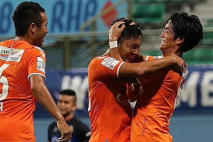 Rui Kumada (centre) is the toast of his team-mates after putting Albirex 3-0 up against Hougang in the 32nd minute. That the White Swans would clinch the league title was in little doubt after that.