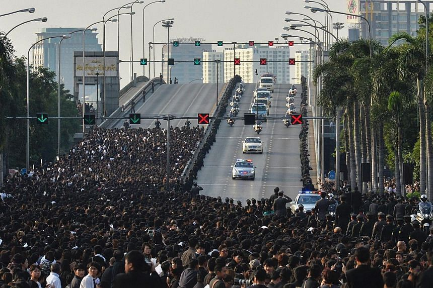 Thais lining the streets to pay their respects as the royal convoy carries the body of King Bhumibol from the Siriraj Hospital, where he died on Thursday, to his riverside Grand Palace in Bangkok. The city was in a sombre mood as Thailand began a yea
