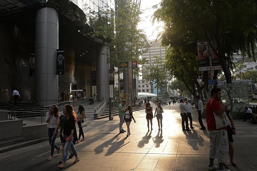 The shopping belt in Orchard Road. Total retail sales in August dropped 1 per cent from last year to an estimated $3.6 billion, the Department of Statistics said yesterday.