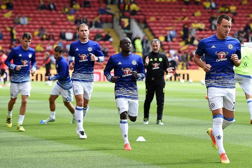 Chelsea's N'Golo Kante (centre) and John Terry warming up before the match against Watford on Aug 20. Conte must now decide whether to keep faith with David Luiz, Gary Cahill and Cesar Azpilicueta or recall Terry, who has recovered from injury.
