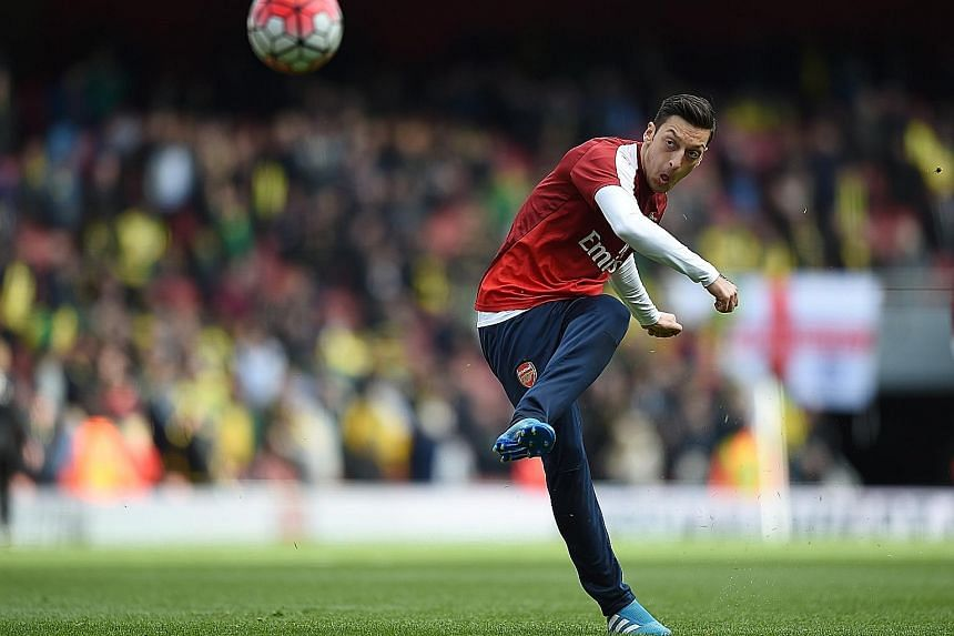 Arsenal's Mesut Ozil is in line to start against Swansea, despite appearing to pick up a slight injury while on international duty with Germany.