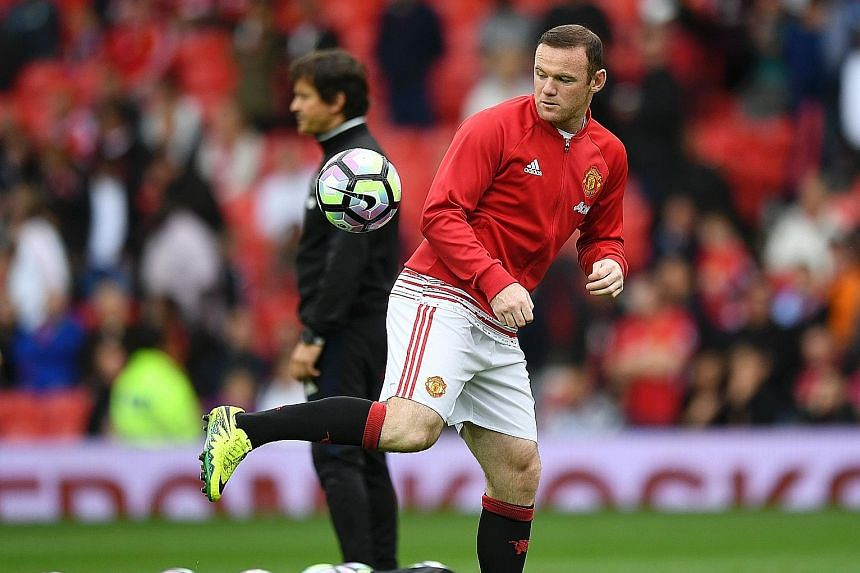 Wayne Rooney warming up before the game against Leicester. He last started for United in the 1-3 loss to Watford four weeks ago.