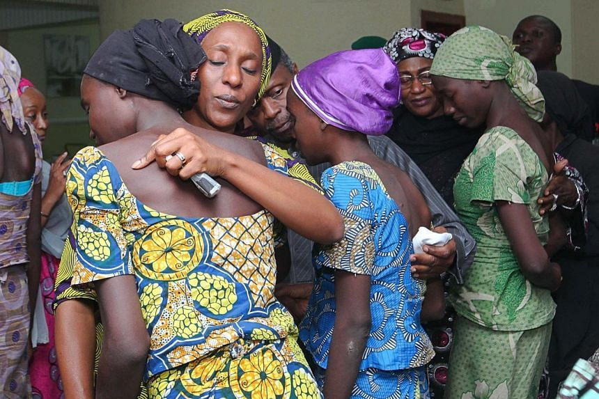 Mrs Oludolapo Osinbajo (second from left), wife of Nigerian Vice-President Yemi Osinbajo , consoling one of the 21 released schoolgirls in Abuja on Thursday. The girls were freed after the Red Cross and the Swiss government brokered a deal with Boko