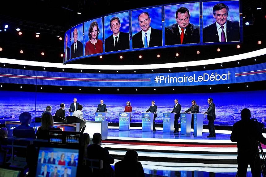 (From left) Mr Bruno Le Maire, Mr Juppe, Ms Nathalie Kosciusko-Morizet, Mr Sarkozy, Mr Jean-Francois Cope, Mr Jean- Frederic Poisson and Mr Fillon in the first televised debate between the seven presidential hopefuls. It was focused on deficit and sp