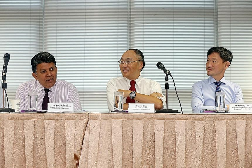 From left: Mr Patrick Daniel, deputy CEO, Mr Alan Chan, CEO, and Mr Anthony Tan, deputy CEO, of Singapore Press Holdings at the meeting announcing the group's full-year results at the SPH News Centre yesterday.