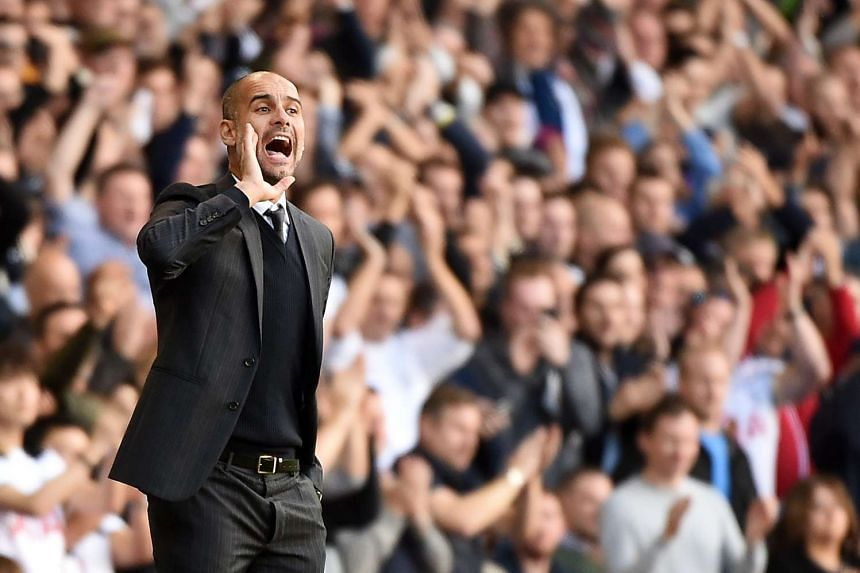 Pep Guardiola reatcs during the English Premier League football match between Tottenham Hotspur and Manchester City.