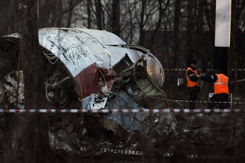 Russian rescue workers inspect the wreckage of the 2010 crash in which Lech Kaczynski and 95 others died.