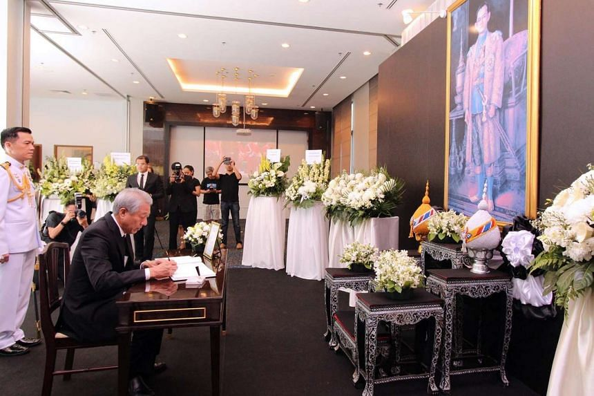 Deputy Prime Minister and Coordinating Minister for National Security Teo Chee Hean signing the condolence book for His Majesty King Bhumibol Adulyadej of the Kingdom of Thailand at the Royal Thai Embassy on Oct 15, 2016.