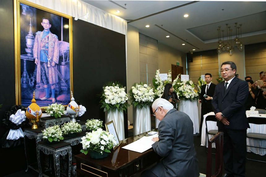 President Tony Tan Keng Yam signing the condolence book for His Majesty King Bhumibol Adulyadej of the Kingdom of Thailand at the Royal Thai Embassy on Oct 15, 2016.