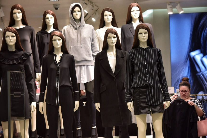 Mannequins in black and white clothing are seen at a shop in Central World in Bangkok on Oct 15, 2016. Most fashion outlets around the city have done the same.