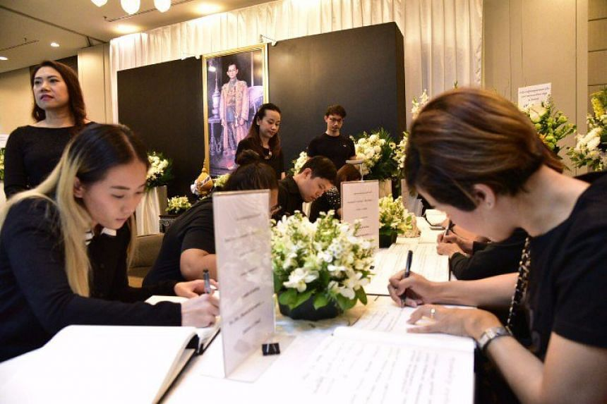 Thais in Singapore pay their respects to the late King Bhumibol Adulyadej at the embassy on Saturday.