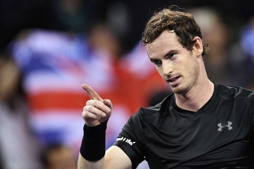 Murray celebrates after winning against Gilles Simon of France.