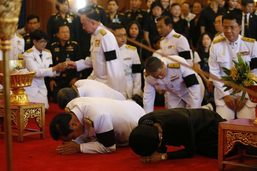 Above: Thai Prime Minister Prayut Chan-o-cha (foreground) and his wife Naraporn paying their respects during the royal funeral bathing ceremony for Thai King Bhumibol Adulyadej at the Sahathai Samakom Pavilion, inside the Grand Palace in Bangkok, yes