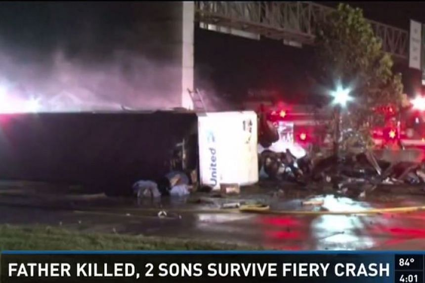 The scene of a fatal crash in Houston, Texas on Oct 14, 2016. A five-year-old boy, who has not been named, told police officers that he pulled his younger brother out of the fire.