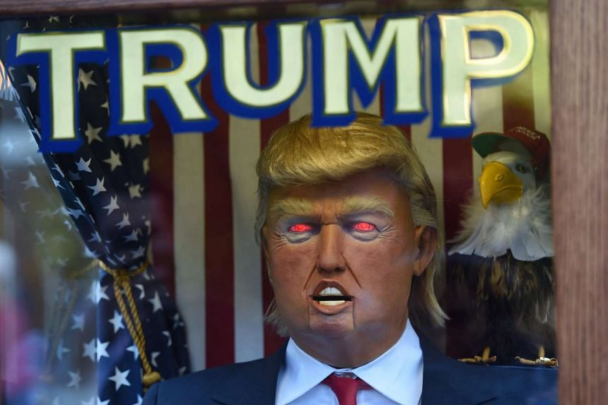 A fortune-telling fairground attraction bearing the likeness of Donald Trump stands at Washington Square Park in New York on Oct 14, 2016.