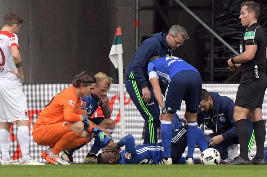 Schalke's wounded player Breel Embolo receiving  medical help on Oct 15, 2016.