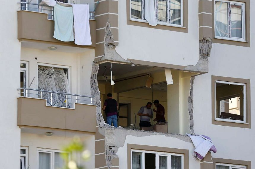Police forensic experts examine an apartment after a blast in the southeastern city of Gaziantep, Turkey, on Oct 16, 2016.
