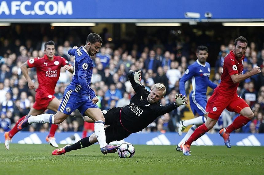 Chelsea's Eden Hazard about to score their second goal past Leicester goalkeeper Kasper Schmeichel. The comprehensive victory was just what Antonio Conte needed after recent speculation about his job security. As for the Foxes, their title defence ha