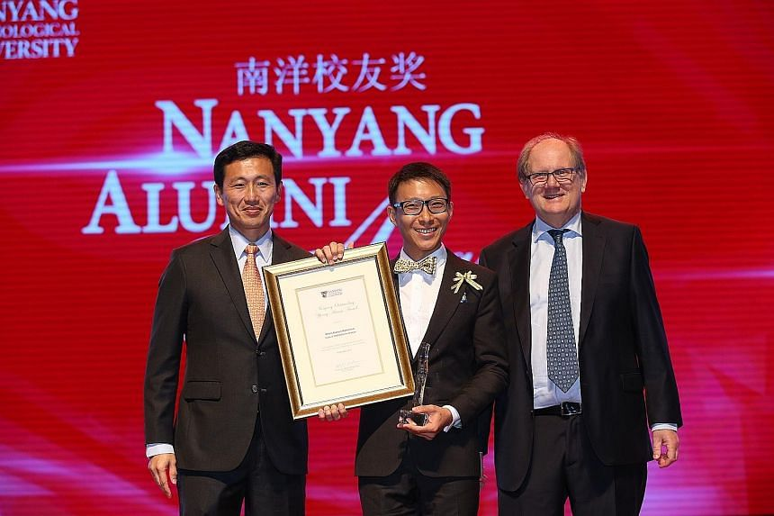 Above: Mr Chern, with his award, is flanked by Mr Ong Ye Kung (left) and NTU president Bertil Andersson (right) at the Nanyang Alumni Awards yesterday. Left: A photograph of the Black Knights in action, one of a series on the elite aerobatics team sh