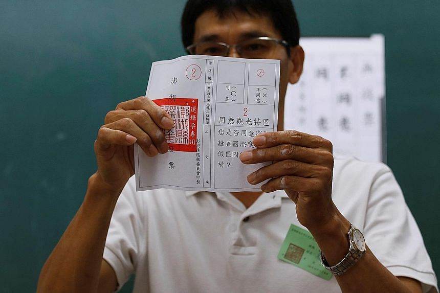 """An official counting a """"no"""" vote yesterday in the referendum on casino development on the island of Penghu, Taiwan. The proposal was overwhelmingly rejected by 81 per cent of the voters."""