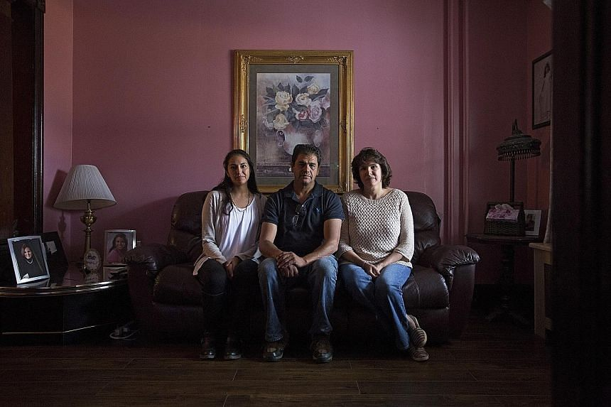 Mr Lara with daughter Amanda and wife Sandra at their home in Hazleton. Its old shopping streets, nearly abandoned in the 1990s, are now lined with Dominican bakeries, travel agencies and Mexican restaurants.