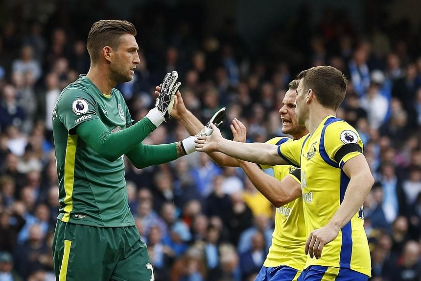 Everton's Maarten Stekelenburg (left) had a stellar game, saving a penalty from Kevin de Bruyne in the first half and guessing right for the second time when he dived low to his left in the second half to save another penalty from Manchester City's S