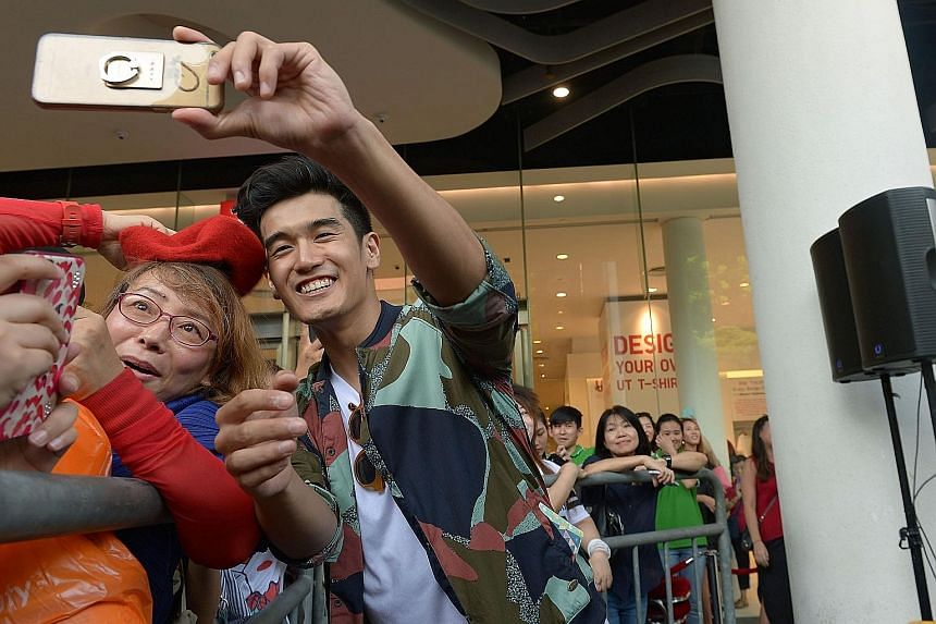 Hartono with his former Chinese tutor Jin Zi Lan, 57, at the meet-and-greet session. For nearly two hours, he crooned, signed autographs, handed out cups of Milo to the crowd and played stage games with fans. Hartono with the Milo crew and fans at Bu