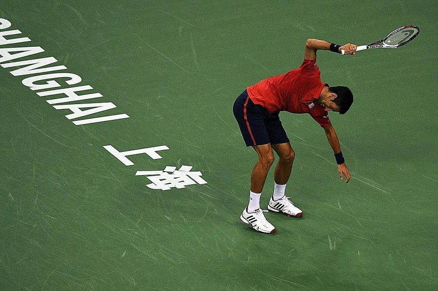 """Novak Djokovic smashing his racket during his 6-4, 6-4 defeat by Roberto Bautista Agut of Spain in the semi-finals of the Shanghai Masters yesterday. """"I knew I could not go on playing at the highest level for so many years all the time,"""" said the Ser"""