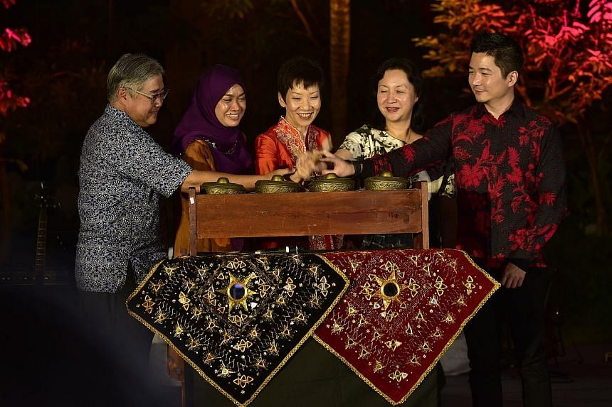 Artefacts that are showcased at the exhibition include a letter press machine (above). At the launch of the Malay CultureFest: (From left) Mr Ong Yew Huat, National Heritage Board chairman; Madam Zuraidah Abdullah, Malay Heritage Foundation chairman;