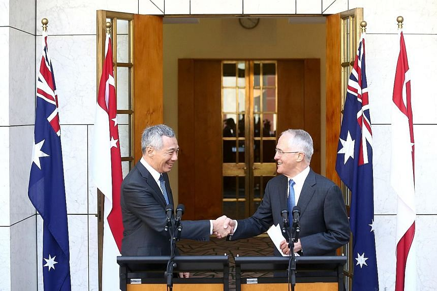 Prof Chan says as a small country, the principles are Singapore's best defence and win the Republic respect. Mr Lee met Mr Turnbull (right) in Australia last week and witnessed the inking of pacts to step up defence, trade, innovation and security ti