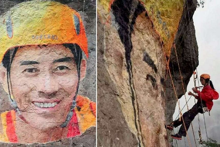 """A female rock climber in China known as """"Lingling"""" used a cliff face as her canvas to paint a 7m-tall portrait of a man she had a crush on."""