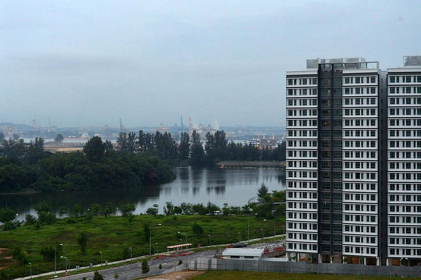 Build-To-Order (BTO) flats at Sumang Walk, Punggol, overlooking the Punggol River, Punggol Island, and the Malaysian port across the Johor Strait.