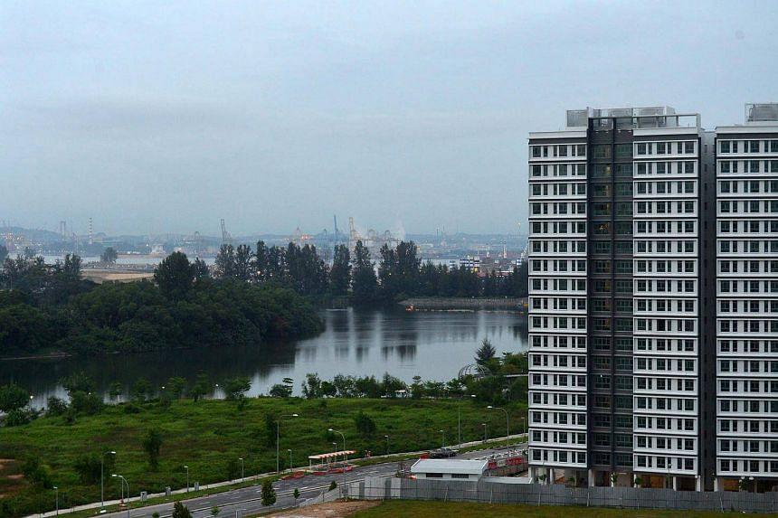 Build-To-Order (BTO) flats at Sumang Walk, Punggol, overlooking the Punggol River, Punggol Island, and the Malaysian port across the Johor Strait.