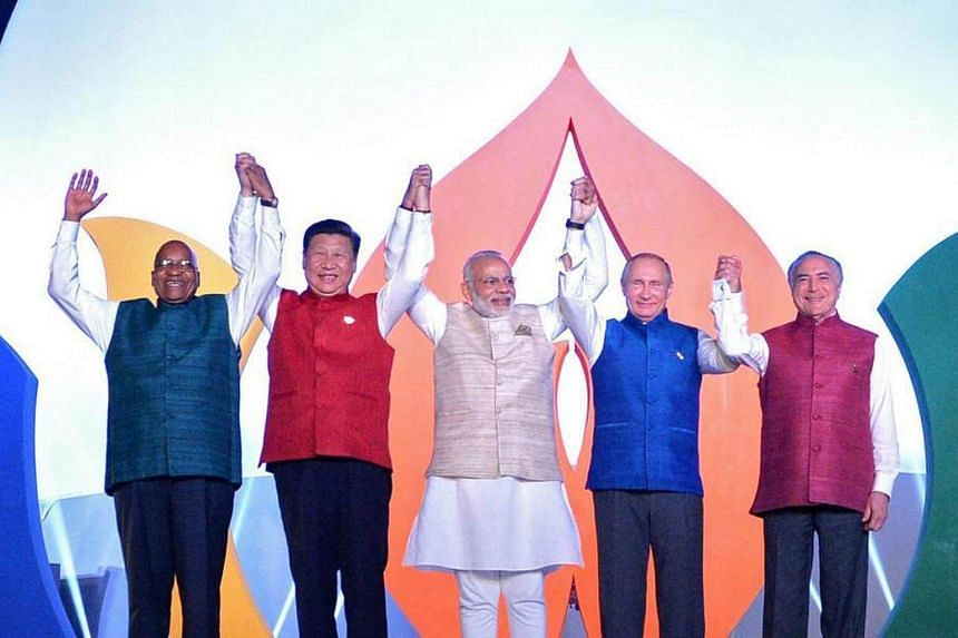 (From left) South African President Jacob Zuma, Chinese President Xi Jinping, Indian Prime Minister Narendra Modi, Russian President Vladimir Putin and Brazilian President Michel Temer pose for a picture during the 8th BRICS summit in Benaulim in the