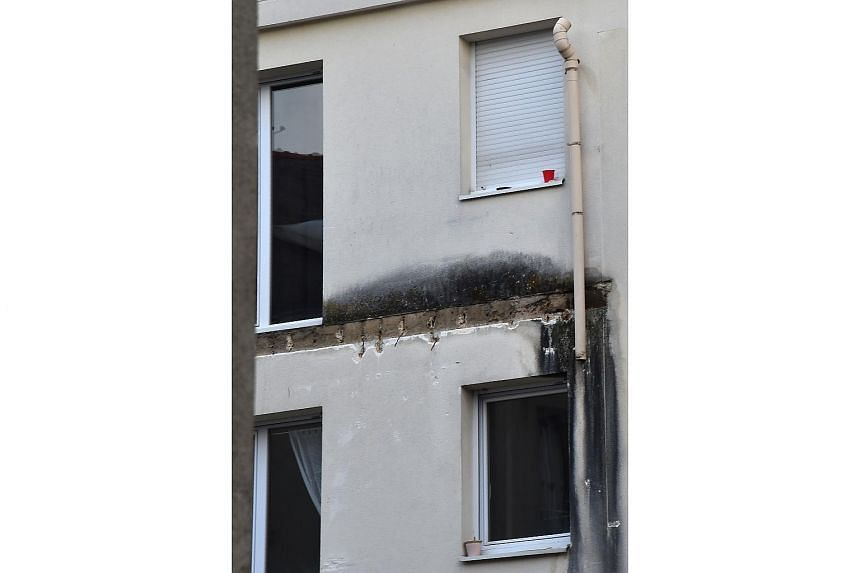 A photo showing windows on the rear side of a building in which four people were killed and several others injured after a balcony collapsed on Oct 16, 2016, in Angers, France.