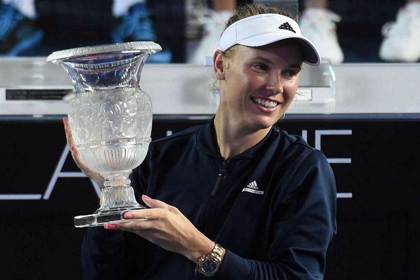 Caroline Wozniacki holding her trophy after winning her finals match against Kristina Mladenovic at the Hong Kong Open on Oct 16, 2016.