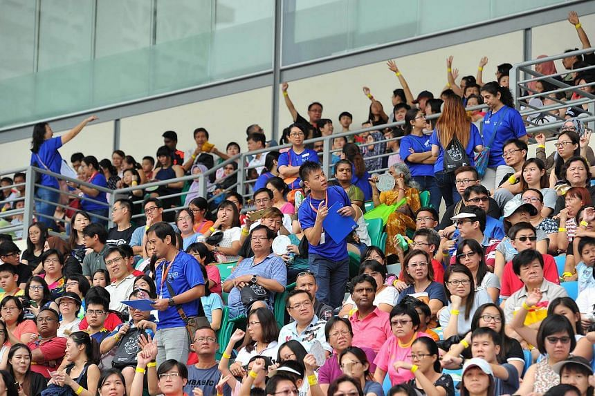 Officials count the participants gathered at Bishan Stadium for the Guinness world record challenge.