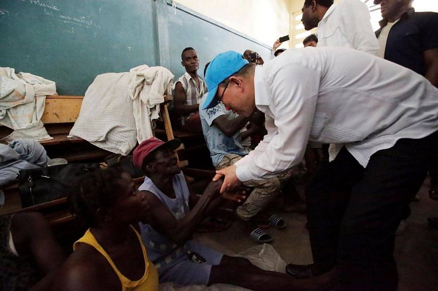 UN Secretary General Ban Ki Moon greets victims staying at a shelter in the Lycee Philippe Guerrier in Les Cayes.