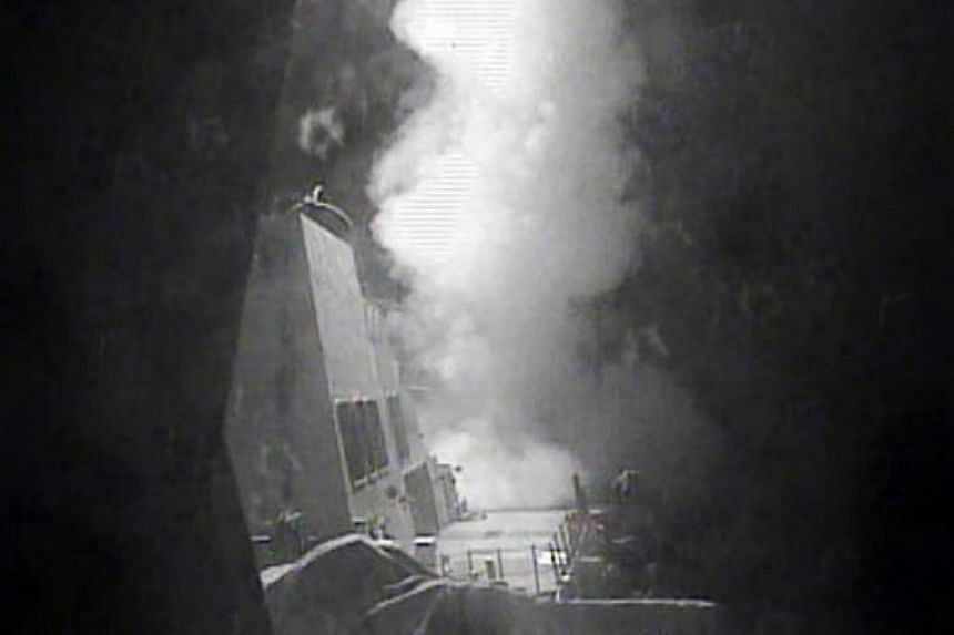 The guided missile destroyer USS Nitze launches a strike against three coastal radar sites in Houthi-controlled territory on Yemen's Red Sea coast, on Oct 13, 2016.