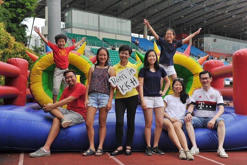 KKH's assistant director of nursing Pauline Wee (in yellow) with some participants of the Guinness world record challenge at Bishan Stadium.