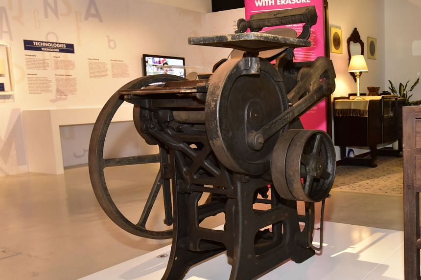 Artefacts that are showcased at the exhibition include a letter press machine (above).
