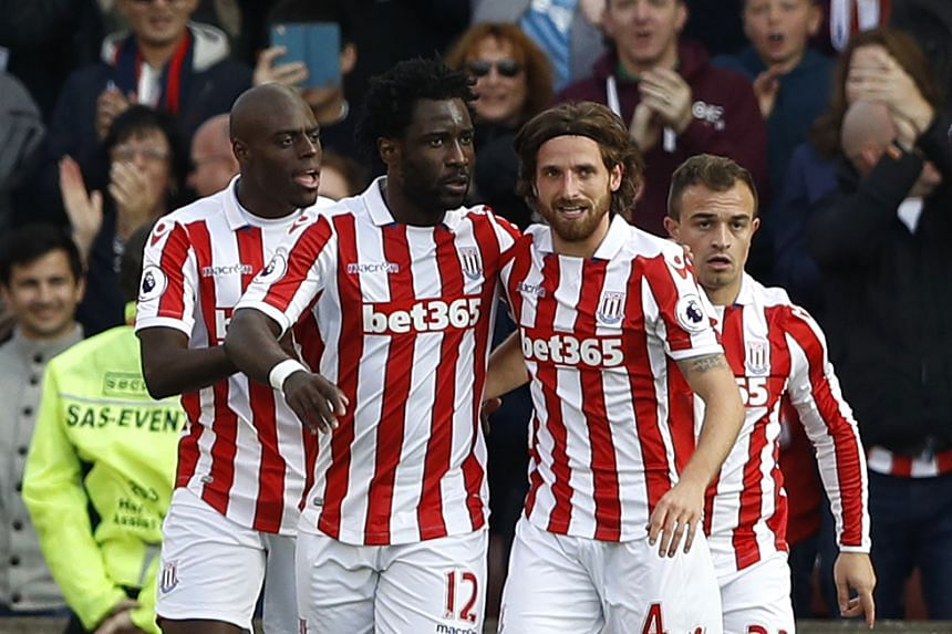 Stoke City's Joe Allen celebrates scoring their first goal with Wilfried Bony.