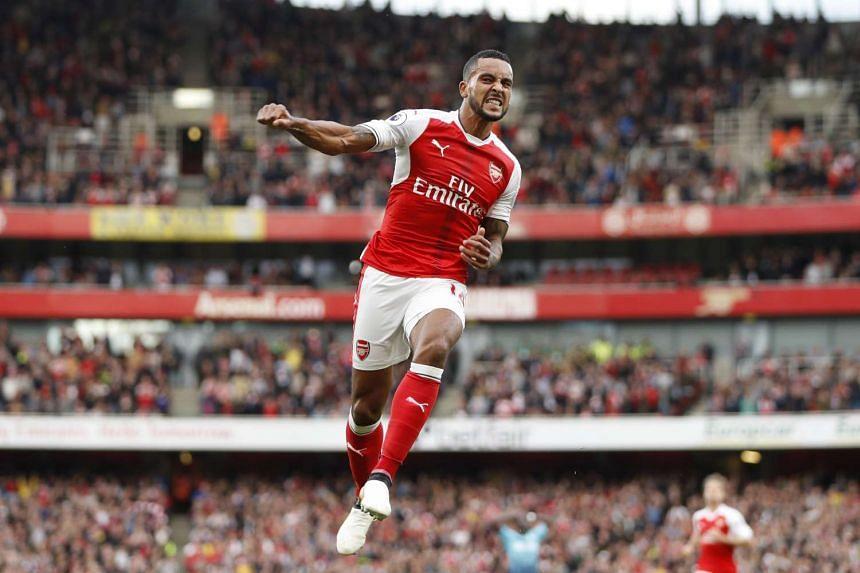 Arsenal's Theo Walcott celebrates scoring their second goal.