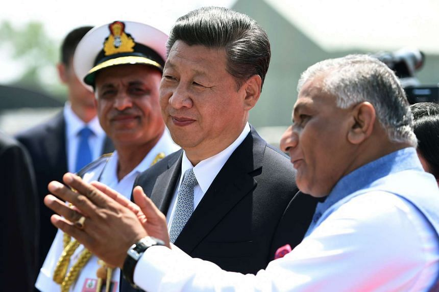 Chinese President, Xi Jinping (centre) talks with Indian Minister of State for External Affairs, General VK Singh on his arrival in Goa on Ocy 15, 2016.