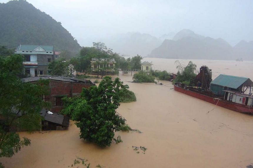 Floods surround houses in Ha Tinh province, Vietnam on Oct 15, 2016.