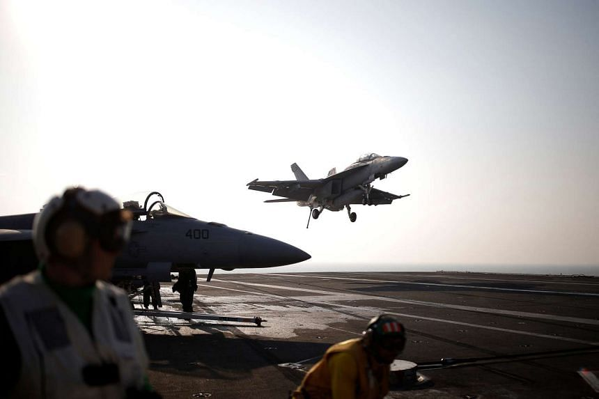 A US Navy F/A-18 Super Hornet prepares to land on the USS Ronald Reagan during a joint naval drill between the US and South Korea, on Oct 14, 2016.