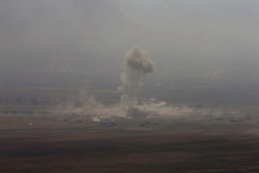 Smoke rises from clashes in the east of Mosul during clashes with Islamic State militants on Oct 17, 2016.