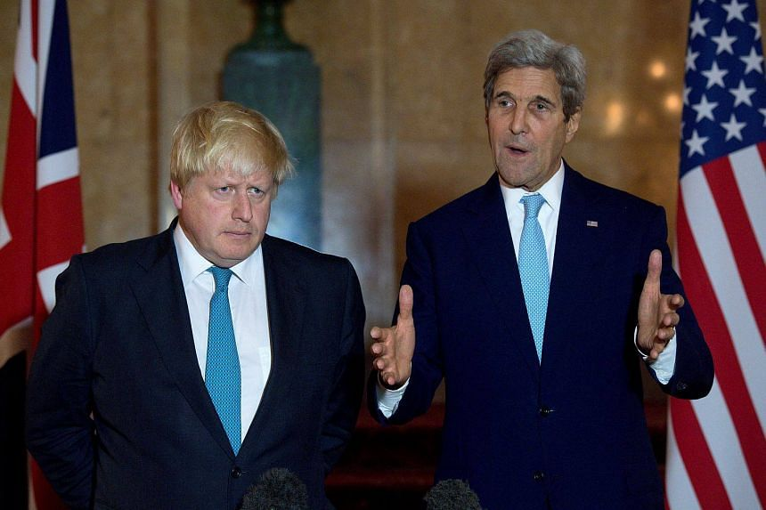 British Foreign Secretary Boris Johnson (left) and US Secretary of State John Kerry give a joint press conference after a meeting on the situation in Syria at Lancaster House in London on Oct 16, 2016.