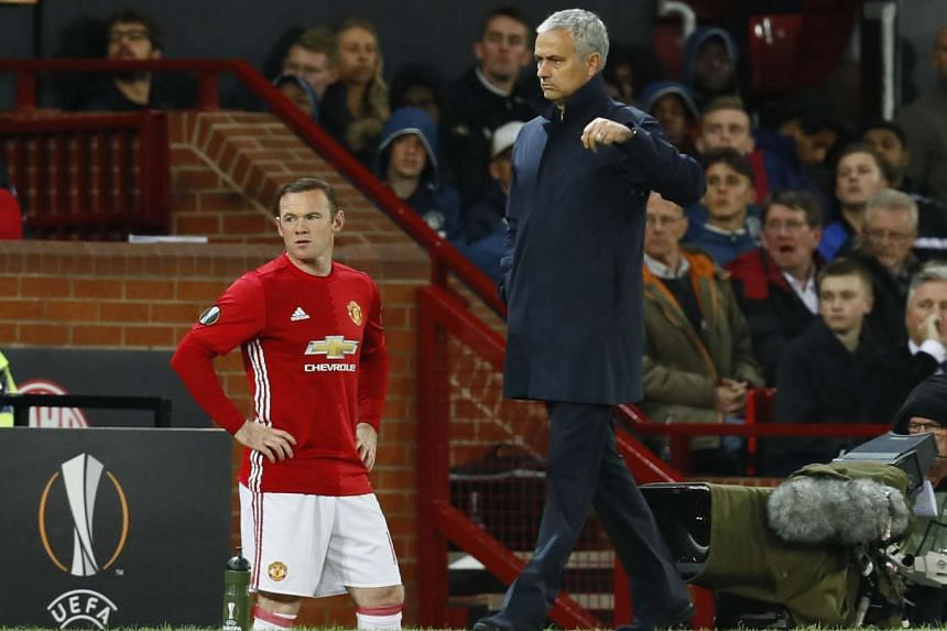 Manchester United manager Jose Mourinho as he prepares to bring on Wayne Rooney.
