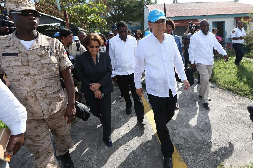 The Secretary general of the United Nations, Ban Ki-moon (centre) visits the school Philippe Griellee, a shelter for families affected by Matthew hurricane, in Les Cayes, Haiti, on Oct 15, 2016.